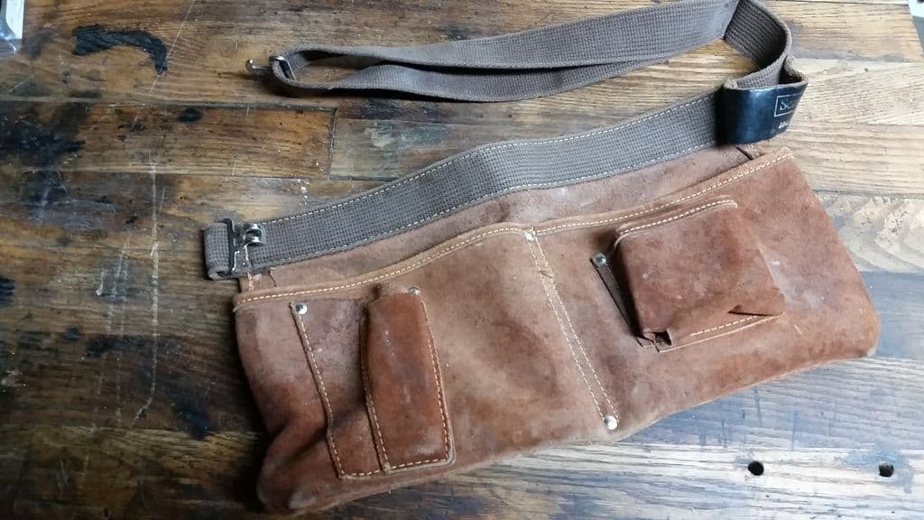 A multi-pocketed tool belt camping